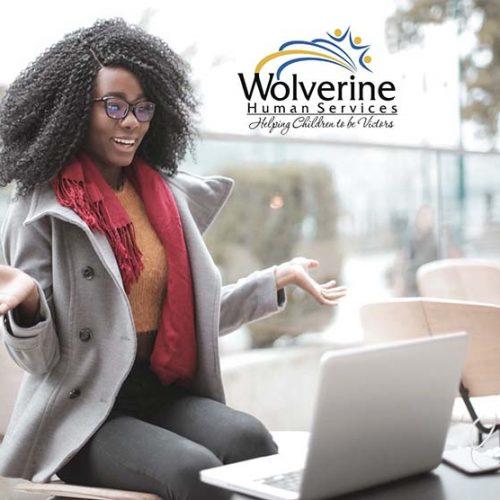 Woman talking on laptop